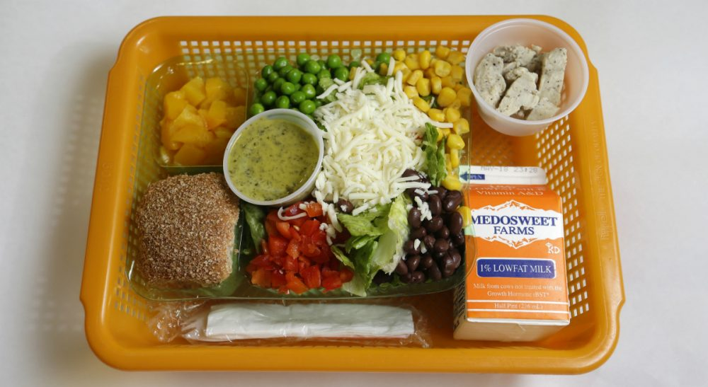 "Ashley Stanley: ""Hunger doesn't require expensive scientific analysis, vaccines or cures. It requires connecting existing resources to people that need it."" Pictured: A school lunch salad entree option featuring low-sodium chicken, a whole-grain roll, fresh red peppers, and cilantro dressing is assembled in a lunch basket at Mirror Lake Elementary School in Federal Way, Wash., south of Seattle, Monday, May 5, 2014. (Ted S. Warren/AP)"