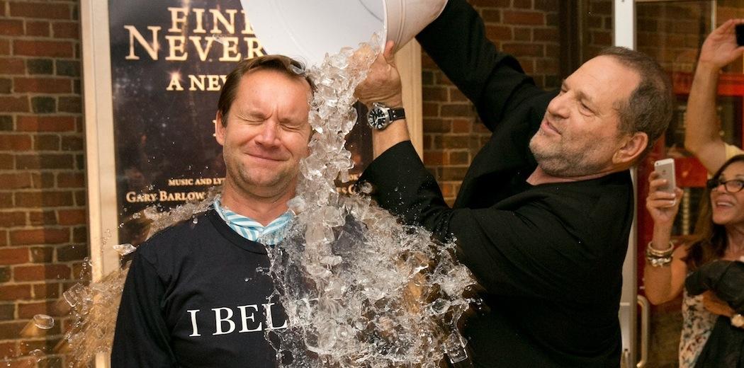 Producer Harvey Weinstein wins an ALS Ice Bucket Challenge against New York Post writer Michael Riedel. (Evgenia Eliseeva)