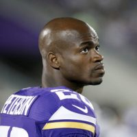Minnesota Vikings running back Adrian Peterson watches from the sidelines against the Oakland Raiders during the second half of a preseason NFL football game at TCF Bank Stadium in Minneapolis, Friday, Aug. 8, 2014. (AP/Ann Heisenfelt)