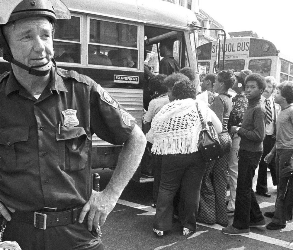 African-American students board a school bus outside South Boston High School on Sept. 12, 1974 — the first day of school and the first day of court-ordered busing. (AP)