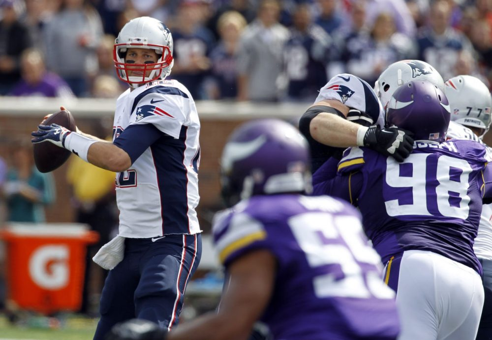 New England Patriots quarterback Tom Brady throws a pass during the second quarter of an NFL football game against the Minnesota Vikings Sunday. (Ann Heisenfelt/AP)