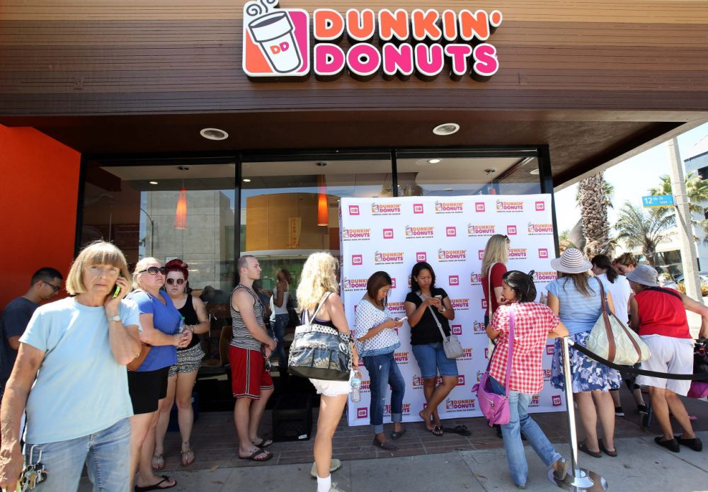 Fans line up for the opening of a Dunkin' Donuts store in Santa Monica, Calif. on Sept. 2. (Nick Ut/AP)