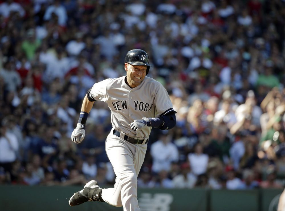 New York Yankees designated hitter Derek Jeter legs out an infield hit against the Boston Red Sox, driving in Ichiro Suzuki, during the third inning of a baseball game Sunday at Fenway Park. This was the last at-bat in Jeter's baseball career. (Steven Senne/AP)