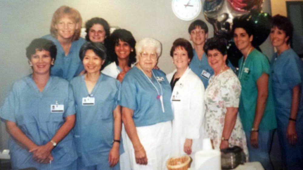 Naimy Gabour Lees, center, surrounded by staff at the hospital where she volunteered for decades. (Courtesy of Lucy Milton)