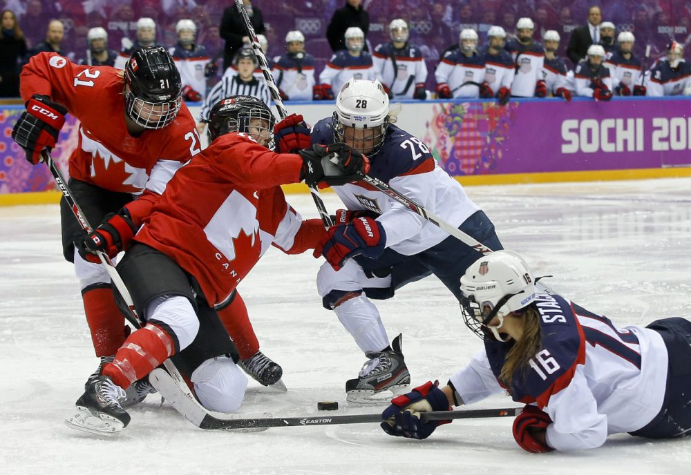 Kelli Stack (16) reaches for the rebound against Canada during overtime of the women's gold medal ice hockey game at the 2014 Winter Olympics. Stack was one of seven players on the U.S. Women's Hockey Team roster who also played for the Boston Blades. (Matt Slocum/AP)