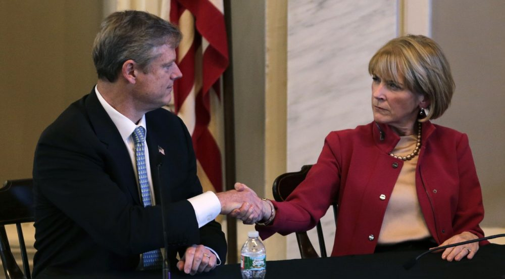 Mass. Republican nominee for governor Charlie Baker, left, shakes hands with Democratic nominee Martha Coakley following a candidates forum at Faneuil Hall on Sept. 24, 2014. (Charles Krupa/AP)