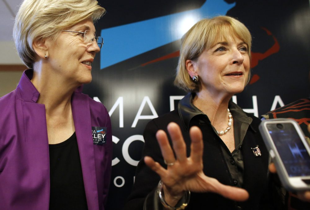 Martha Coakley, right, speaks with reporters alongside U.S. Senator Elizabeth Warren following a roundtable discussion at offices of the Service Employees International Union last month. (Steven Senne/AP)