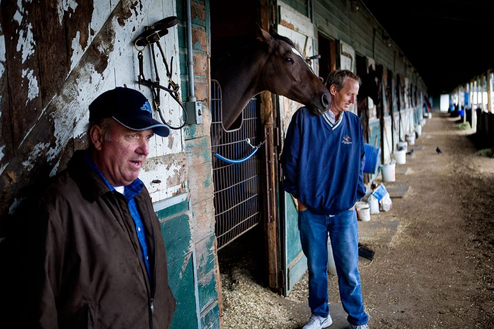 Horse trainer Wayne Marcoux, left, and owner Michael Cook at Suffolk Downs this week (Jesse Costa/WBUR)