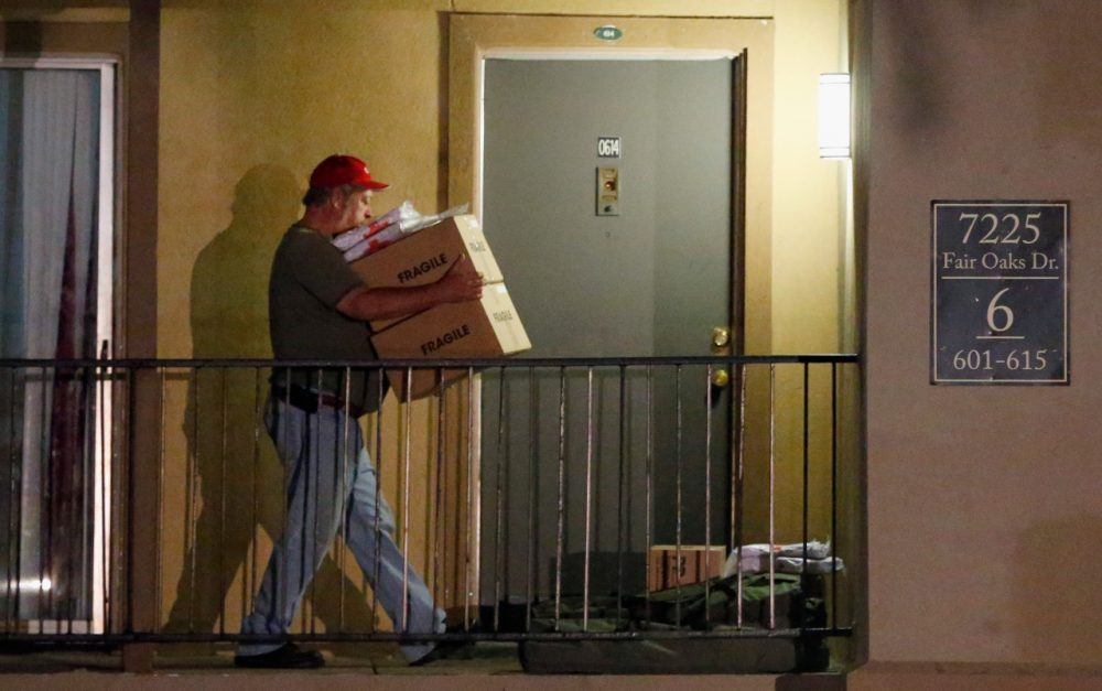Volunteers from the Red Cross deliver blankets and other supplies to a unit at the Ivy Apartments, where the confirmed Ebola virus patient was staying, on October 2, 2014 in Dallas, Texas. (Tom Pennington/Getty Images)