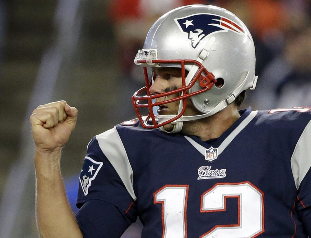 Patriots quarterback Tom Brady tossed two touchdowns in New England's 43-17 win. (Steven Senne/AP)