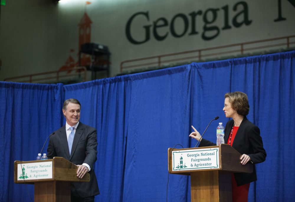 Georgia Democratic candidate for U.S. Senate Michelle Nunn, right, speaks as Republican candidate David Perdue looks on during a debate, Tuesday, Oct. 7, 2014, in Perry, Ga. (David Goldman/AP)