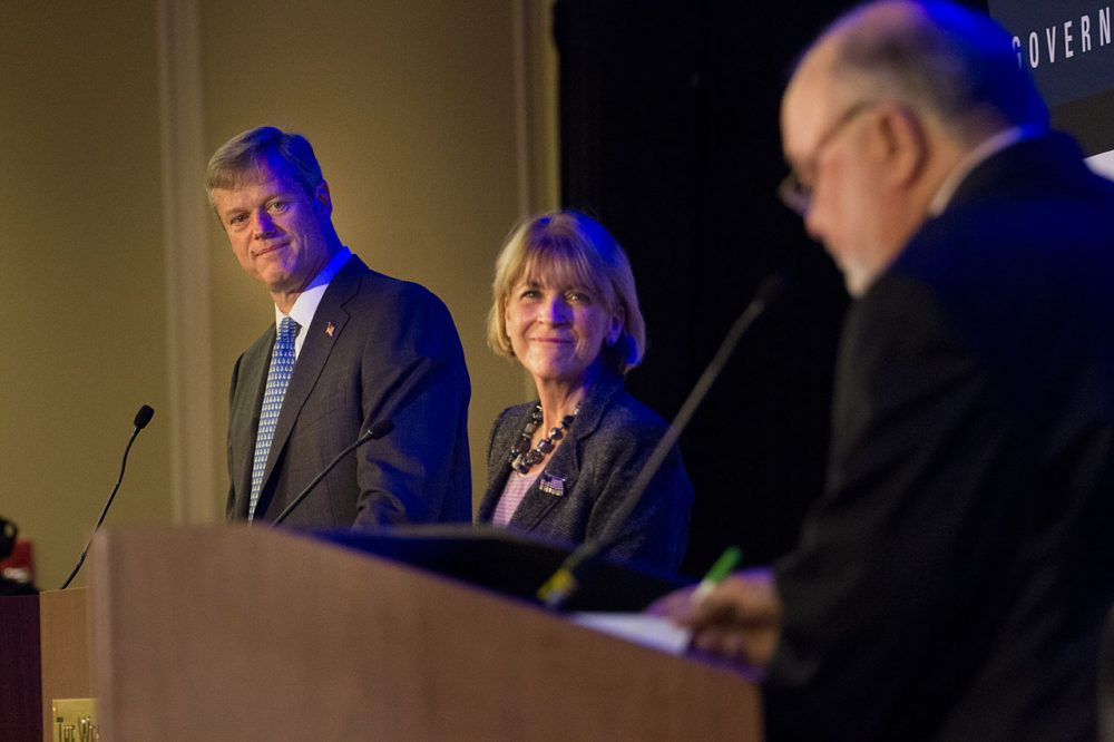 Republican Charlie Baker and Democrat Martha Coakley participate in a Greater Boston Chamber of Commerce debate. WBUR's Bob Oakes, right, moderates. (Jesse Costa/WBUR)
