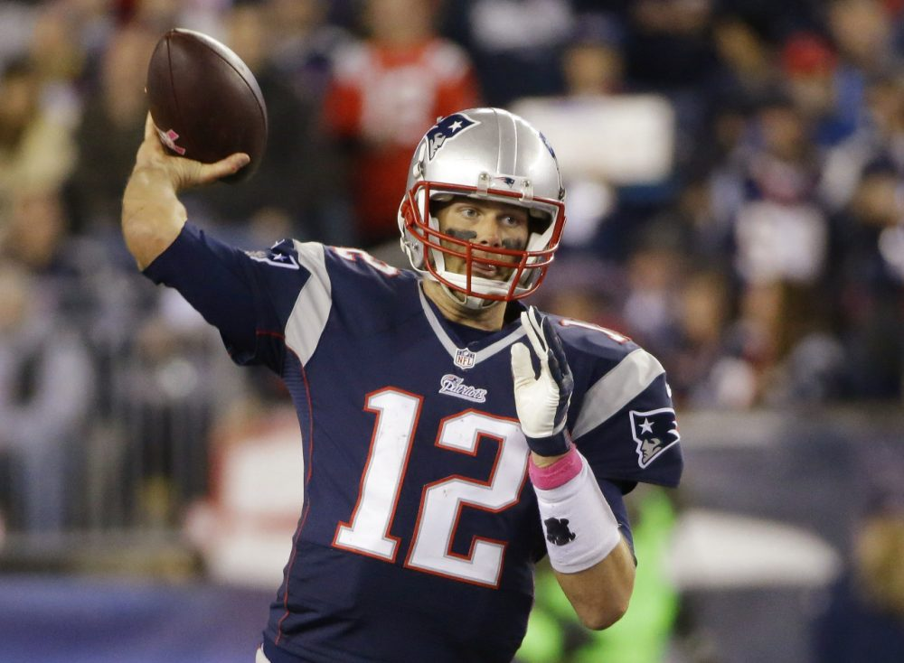 New England Patriots quarterback Tom Brady (12) passes the football in the first half of an game against the Cincinnati Bengals Sunday. (Stephan Savoia/AP)