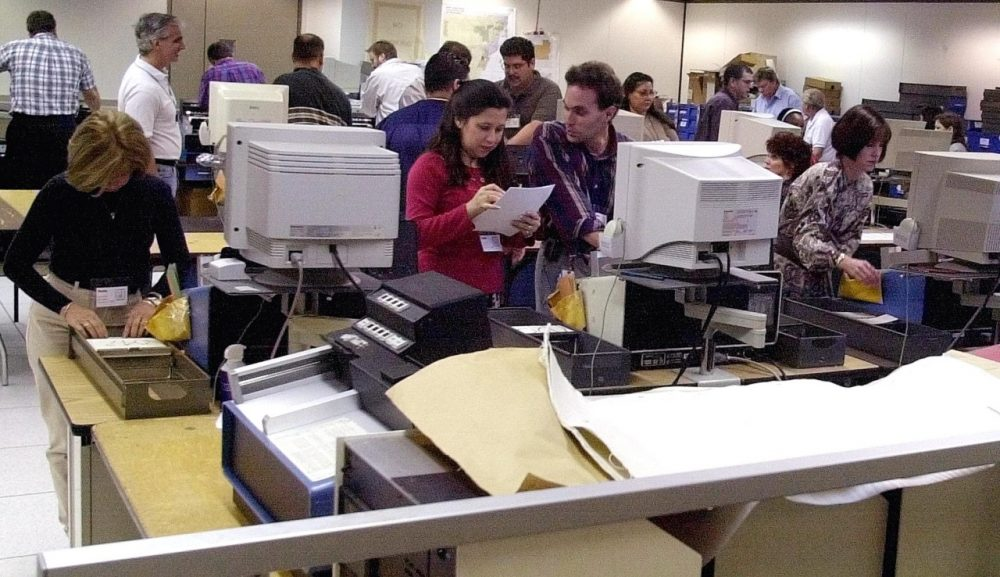 Workers at the Miami-Dade election headquarters in downtown Miami, Florida, recount the ballots of the county November 8, 2000, the day after the presidential election. Fourteen years after the much contested election, Florida remains a decisive state. (Rhona Wise/AFP/Getty Images)