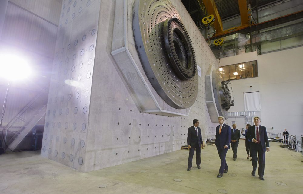 Secretary of State John Kerry, center, and British Foreign Secretary Philip Hammond, right, tour the Wind Technology Testing Center in Boston Thursday. (Stephan Savoia/AP)
