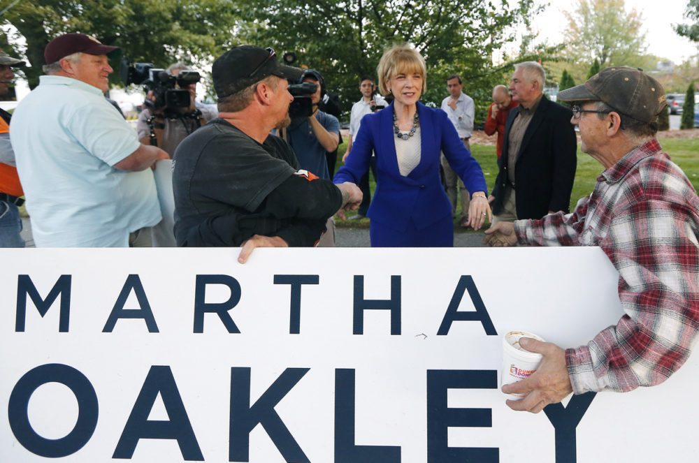 Martha Coakley greets supporters as she arrives at the WBZ studios in Boston for a debate Tuesday. (Elise Amendola/AP)