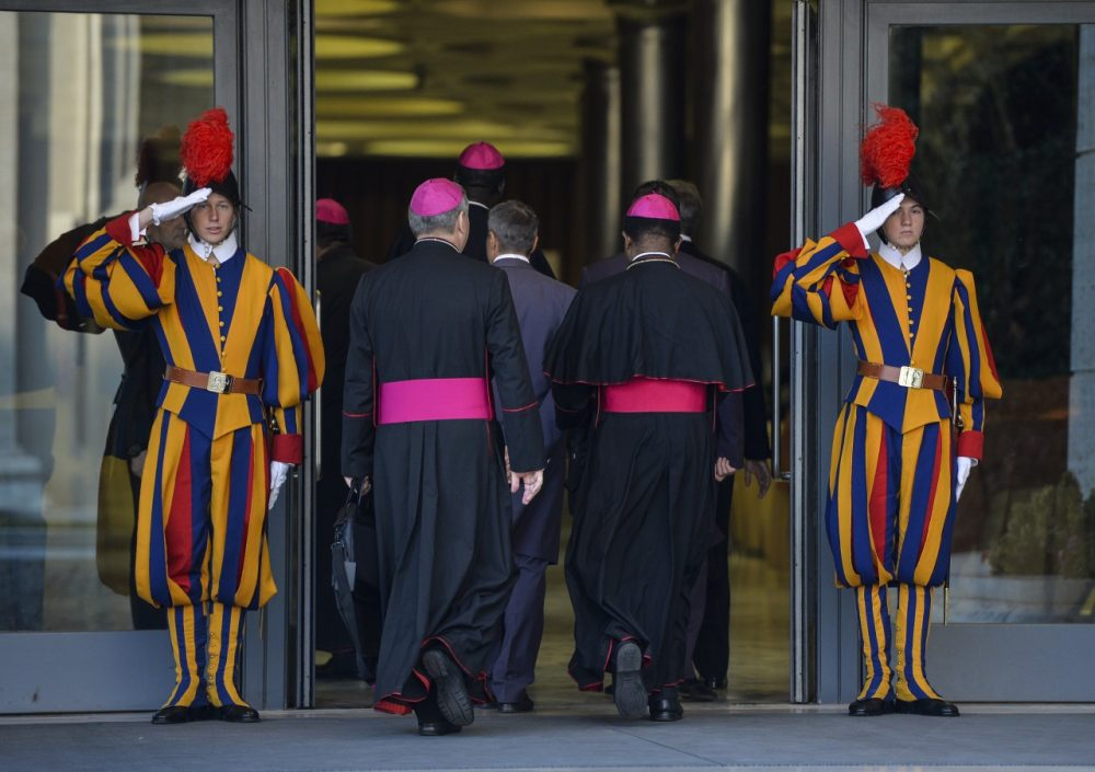 Bishops arrive at the Synod on the Families, in the Synod Aula, at the Vatican, on October 6, 2014. The Pontiff on Sunday launched a major review of Catholic teaching on the family that could lead to change in the Church's attitude to marriage, cohabitation and divorce. (Andreas Solaro/AFP/Getty Images)