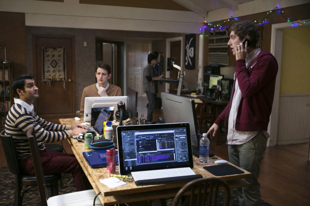 """Kumail Nanjiani, Zach Woods and Thomas Middleditch in a scene from the television series, """"Silicon Valley,"""" in which characters seek venture capital and try to launch a startup called Pied Piper. (HBO, Jaimie Trueblood/AP)"""