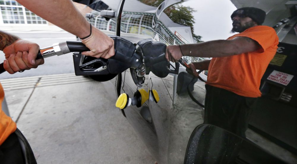 Dana Ripley, of Winthrop, Mass., fills the gas tank of his truck at a service station in Andover, Mass. (Charles Krupa/AP)