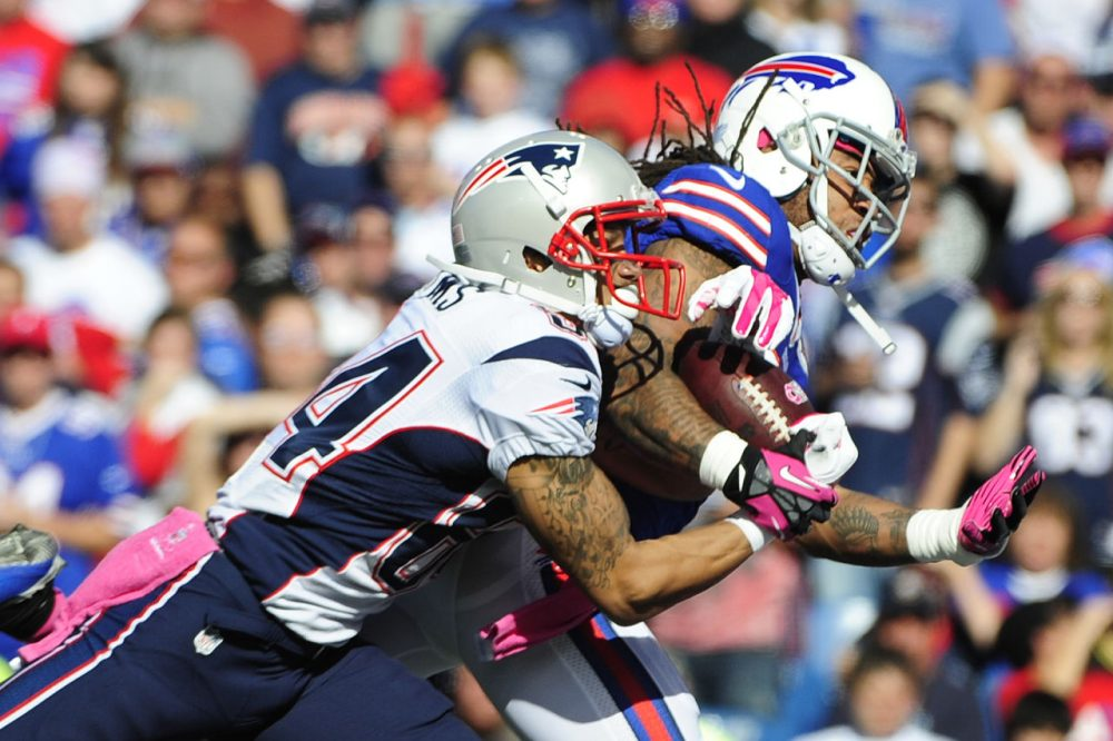 New England Patriots wide receiver Brian Tyms (84) catches a pass for a touchdown as he is defended by Buffalo Bills' Stephon Gilmore (24).(Gary Wiepert/AP)
