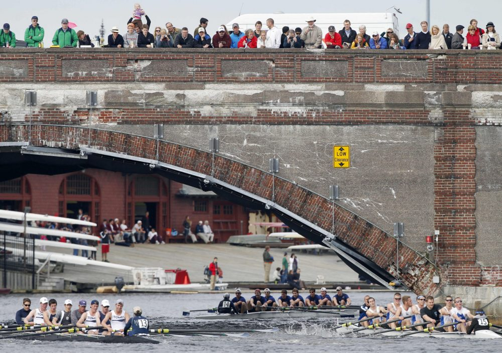 A crowd gathered on a bridge to watch the 2016 Head of the Charles Regatta. (Michael Dwyer/AP)