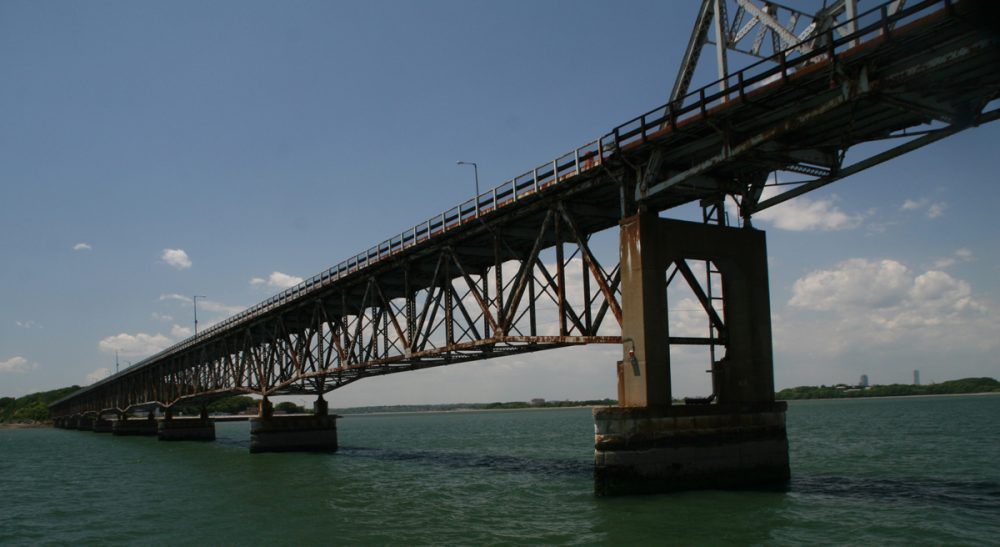 """Steve Brown: """"The bridge was a metaphor for the connection we on the mainland had with those served by the programs on Long Island: It was shaky. It was tenuous. But at least it was there."""" Pictured: The Long Island Viaduct spanning Quincy Bay, in the middle of Boston Harbor, 2009. (docsearls/Flickr)"""