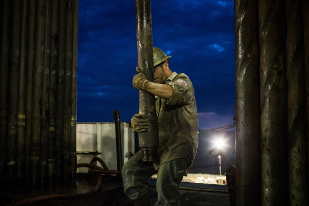 Oil prices are at a four year low. One of the contributing factors is the shale boom, as on the Bakken Shale in North Dakota. Pictured here Scott Berreth, a derrick hand for Raven Drilling, works on an oil rig drilling into the Bakken shale formation on July 28, 2013 outside Watford City, North Dakota. (Andrew Burton/Getty Images)