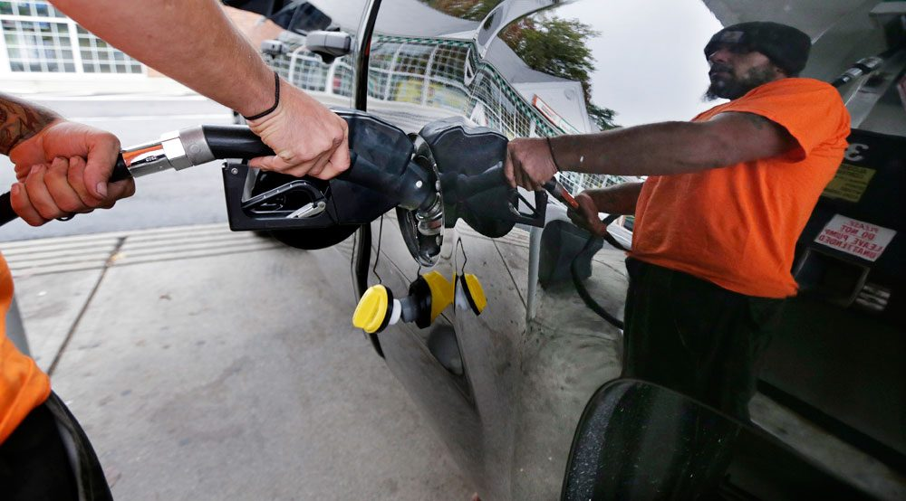 Dana Ripley, of Winthrop, fills the gas tank of his truck in Andover on Sept. 30. (Charles Krupa/AP)