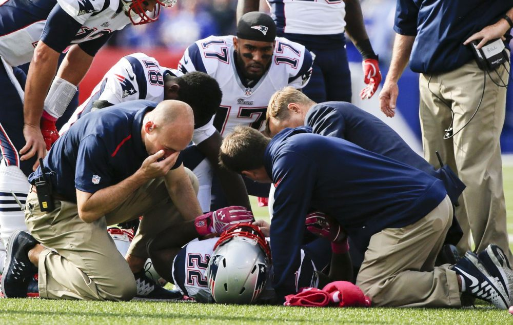 Trainers assist Stevan Ridley (22) after he was injured on a play in the second half of the Patriots' game against the Buffalo Bills. (Mike Groll/AP)
