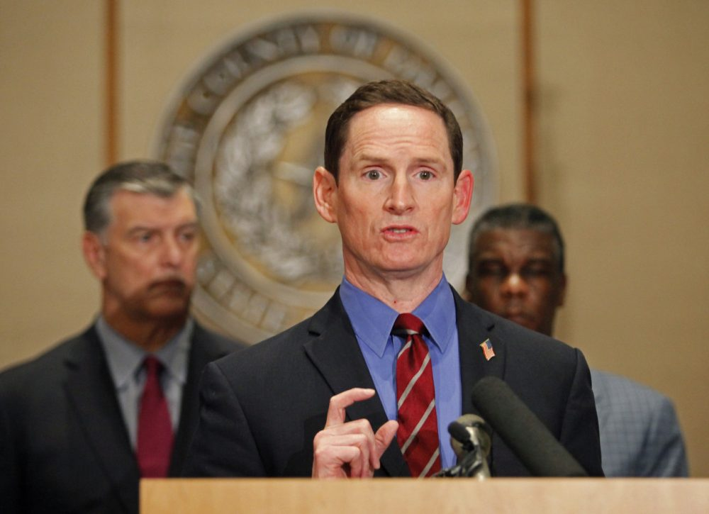 Dallas County Judge Clay Jenkins answers questions at the podium during a press conference held at the Dallas County Commissioners Court concerning the second health care worker to contract Ebola. (Stewart F. House/Getty Images)