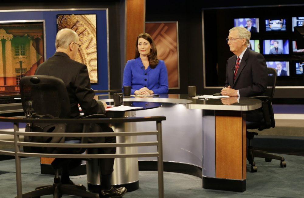 "U.S. Senate Minority Leader Mitch McConnell (R) Ky., right, and  Democratic opponent, Kentucky Secretary of State Alison Lundergan Grimes, before their appearance on ""Kentucky Tonight"" television broadcast live from KET studios in Lexington, Ky., on Oct. 13, 2014. (Pablo Alcala/Herald-Leader via Getty Images)"
