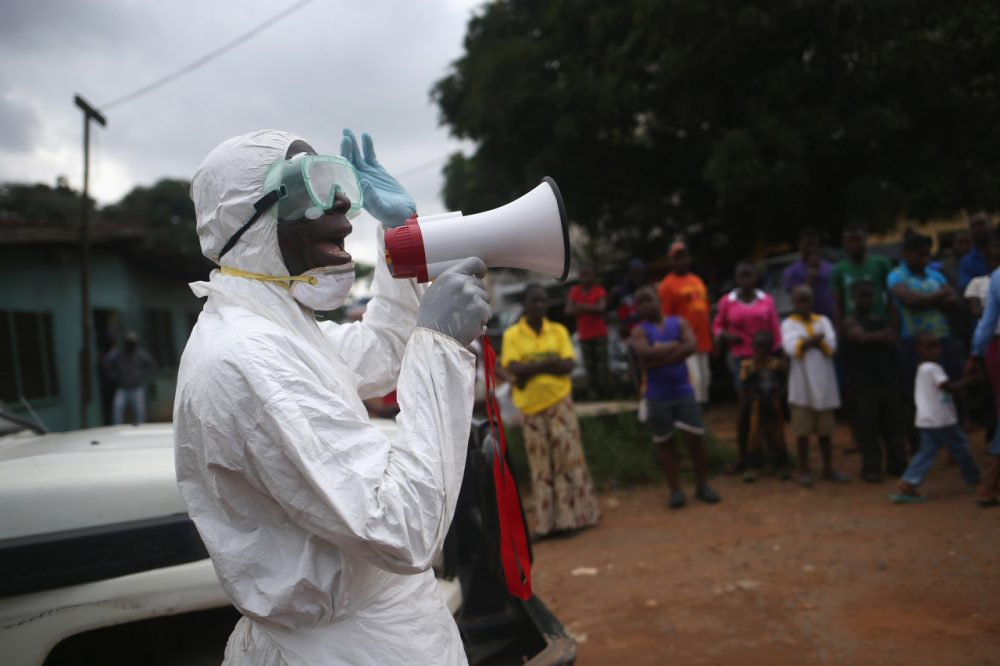 Aid workers from the Liberian Medical Renaissance League stage an Ebola awareness event on October 15, 2014 in Monrovia, Liberia.(John Moore/Getty Images)