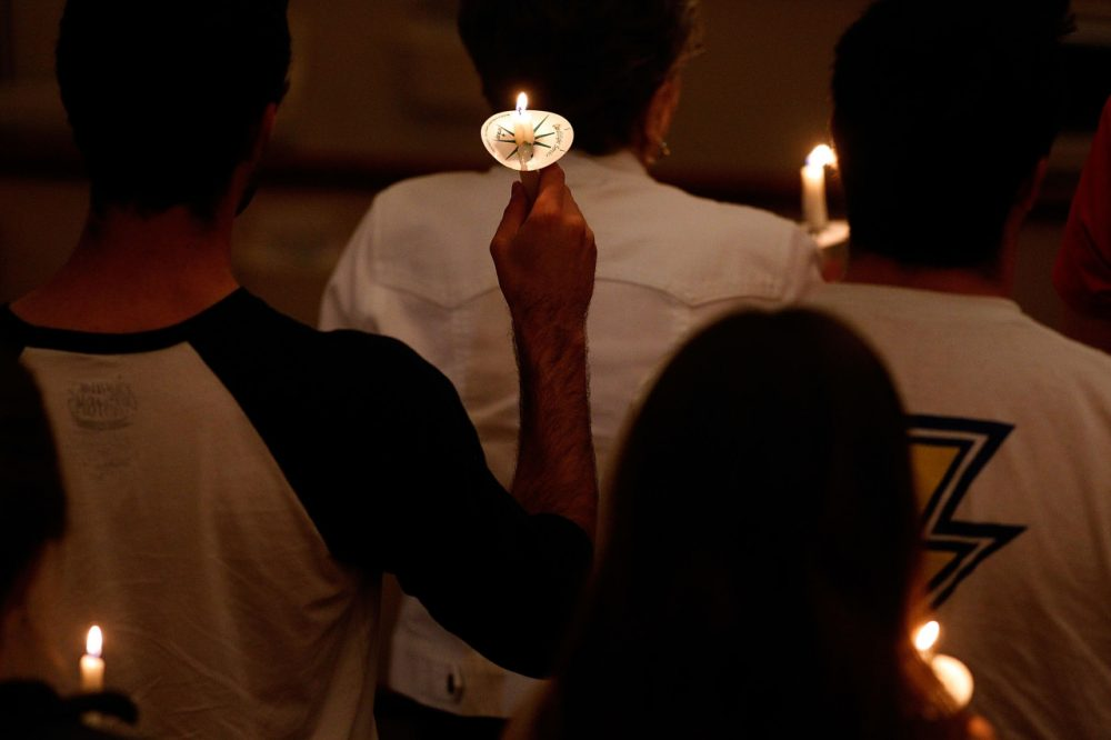 Attendees hold candles at a prayer vigil on the campus of TCU for health care worker Nina Pham who was diagnosed with the Ebola virus on October 14, 2014 in Dallas, Texas. (Mike Stone/Getty Images)