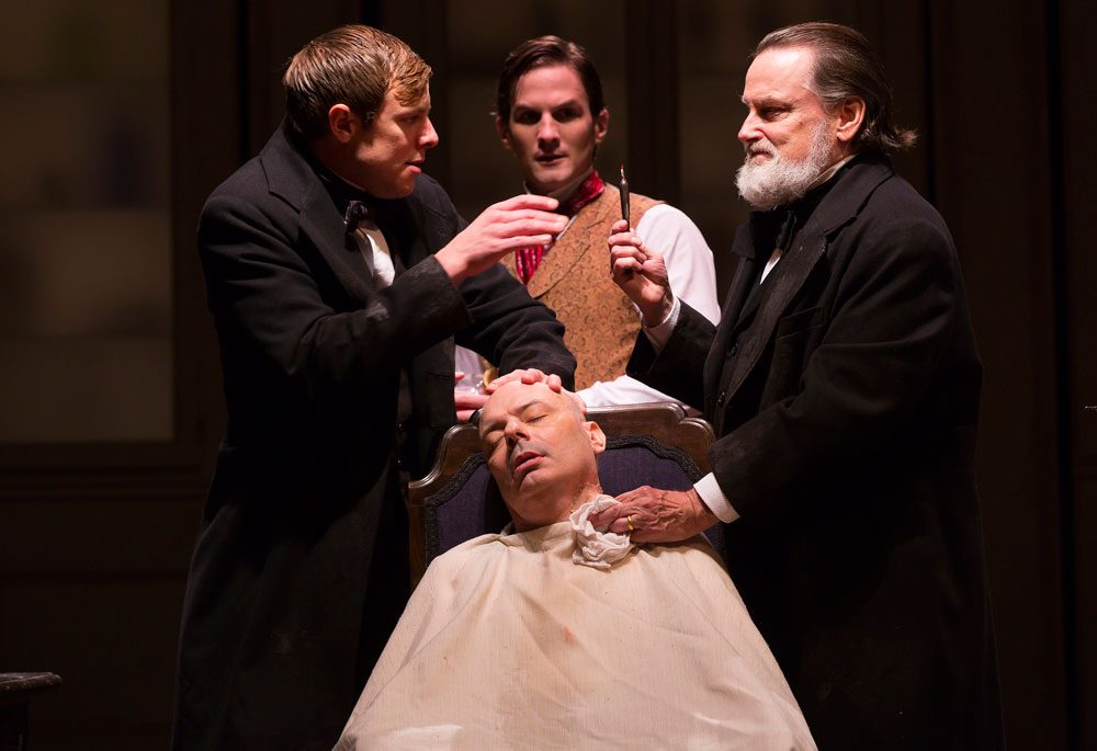 "Greg Balla, Lee Sellars (seated), Tom Patterson and Richmond Hoxie act in a scene from ""Ether Dome."" (Courtesy T. Charles Erickson/Huntington Theatre)"