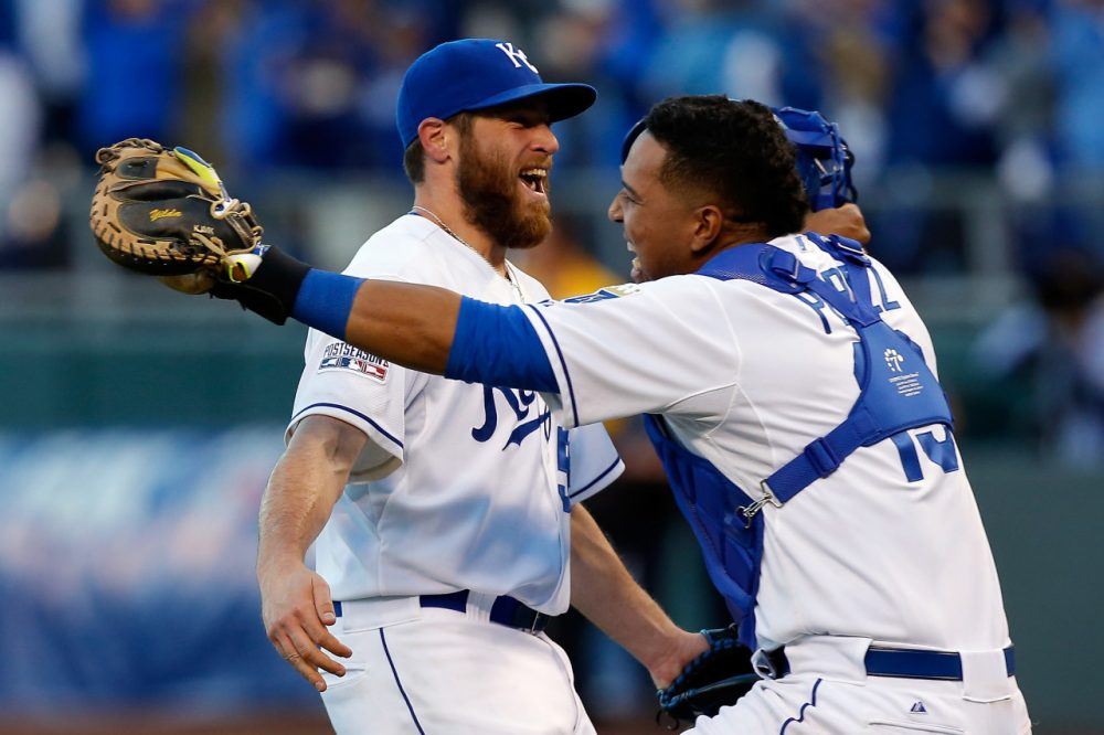 Greg Holland #56 and Salvador Perez #13 of the Kansas City Royals celebrates their 2 to 1 win over the Baltimore Orioles to sweep the series in Game Four of the American League Championship Series at Kauffman Stadium on October 15, 2014 in Kansas City, Missouri. (Ed Zurga/Getty Images)