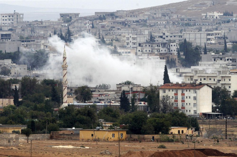 Smoke rises from the Syrian town of Kobani, on October 17, 2014. Islamic State militants have suffered setbacks and have begun retreating from parts of the beseiged Syrian border town according to a local official. (Gokhan Sahin/Getty Images)