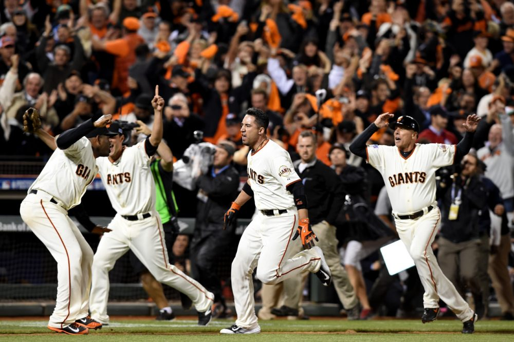 With a dramatic walk-off home run from Travis Ishikawa (center), the San Francisco Giants punched their ticket to the World Series. (Thearon W. Henderson/Getty Images)