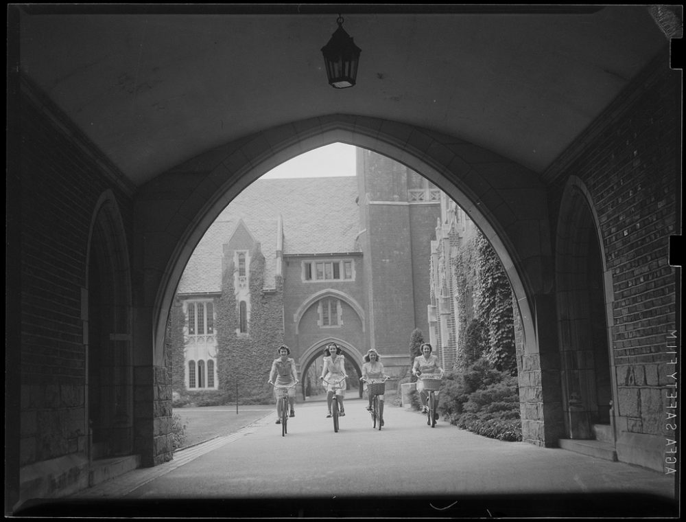 Wellesley students bicycle on campus. (Boston Public Library/Flickr)