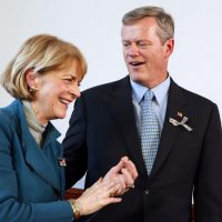 Massachusetts gubernatorial candidates, Democrat Martha Coakley, left, and Republican Charlie Baker stand together after participating in the Greater Boston Interfaith Candidates Forum at Fourth Presbyterian Church in Boston, Sunday, Oct. 26, 2014. (Michael Dwyer/AP)