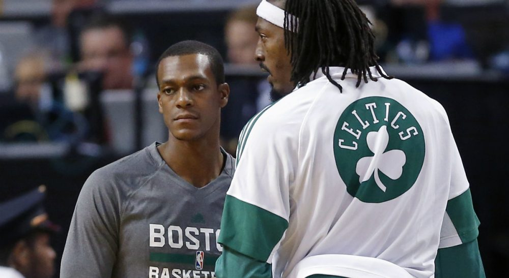 "Peter May: ""There are Celtics' fans out there who care about the team. But in the current New England sports solar system, the Celtics are whatever comes after Pluto."" Pictured: Boston Celtics guard Rajon Rondo, left, talks with forward Gerald Wallace during a preseason game in Boston, Wednesday, Oct. 22, 2014. (Elise Amendola/AP)"