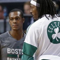"""Peter May: """"There are Celtics' fans out there who care about the team. But in the current New England sports solar system, the Celtics are whatever comes after Pluto."""" Pictured: Boston Celtics guard Rajon Rondo, left, talks with forward Gerald Wallace during a preseason game in Boston, Wednesday, Oct. 22, 2014. (Elise Amendola/AP)"""