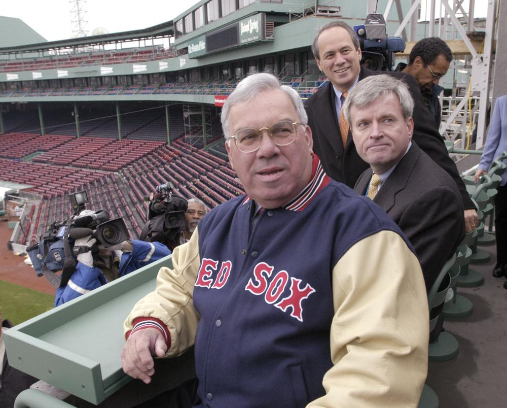 Mayor Menino is given a tour on April 3, 2003, of the new seating area above the Green Monster at Fenway Park. He's joined by Boston city services representative Mike Galvin, center, and Red Sox executive Larry Lucchino, background. (Josh Reynolds/AP)
