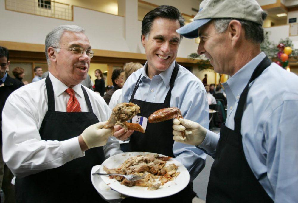 Mayor Menino, then-Massachusetts Gov. Mitt Romney, center, and NSTAR CEO Tom May compare turkey portions while taking a break from serving turkey at the Goodwill Thanks-For-Giving Dinner in Boston on Nov. 24, 2004. (Steven Senne/AP)