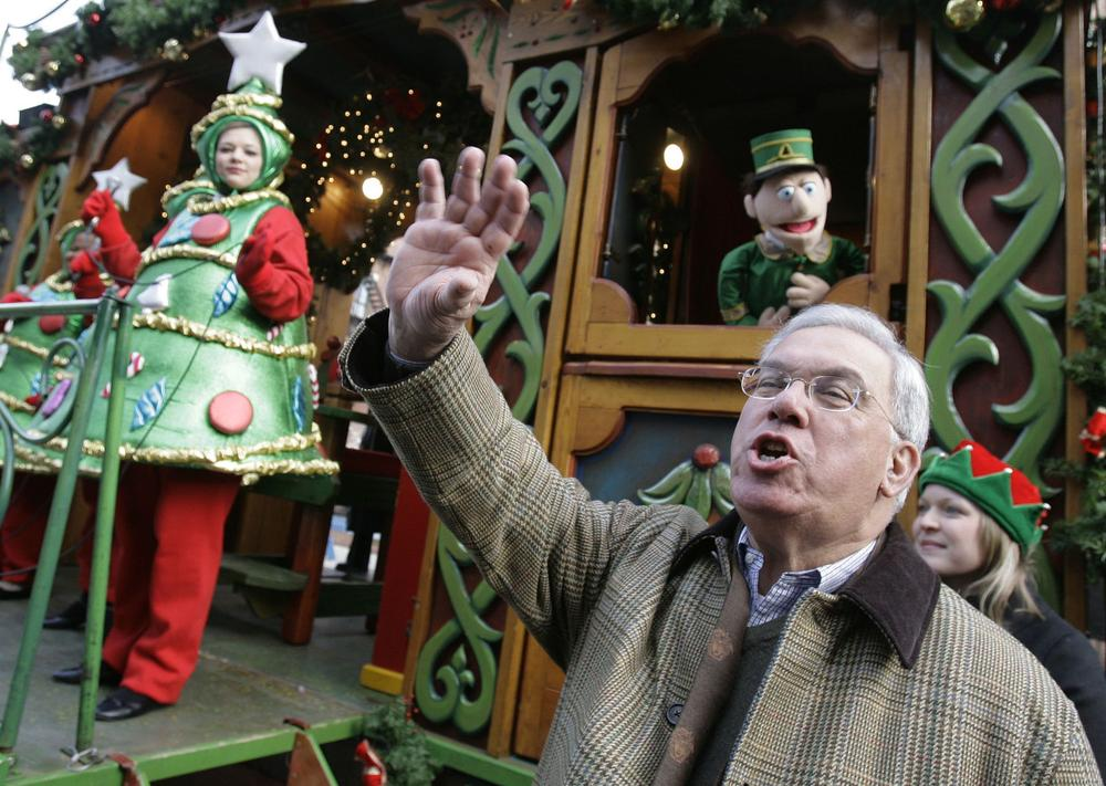 Mayor Menino waves to the crowd during a Christmas tree lighting ceremony in the North End neighborhood of Boston in 2006. (Michael Dwyer/AP)