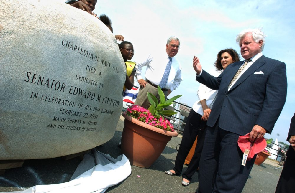 Sen. Edward M. Kennedy, D, Mass., right, admires a monument following the dedication of Pier 4 to Kennedy at the Charlestown Navy Yard in 2002. Kennedy is standing with his wife, Victoria Reggie Kennedy, and Boston Mayor Thomas Menino. (Lisa Poole/AP)