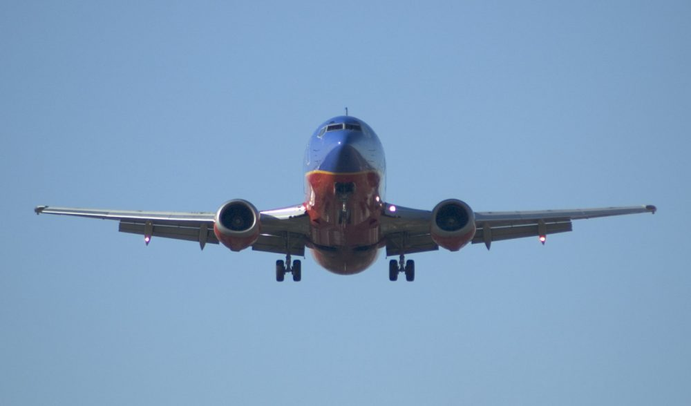 A Southwest Airlines flight Boeing 737 flies over Bachman Lake near Dallas (brentdanley/Flickr)