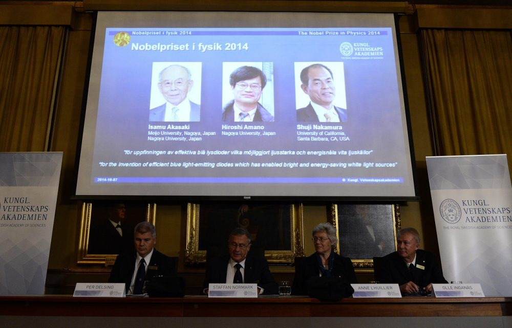 A giant screen displays the images of (up, L to R) Japanese-born researchers Isamu Akasaki, Hiroshi Amano and Shuji Nakamurawho received the 2014 Nobel Prize in Physics on October 7, 2014 at the Royal Swedish Academy of Science in Stockholm, Sweden. (Jonathan Nackstrand/AFP/Getty Images)