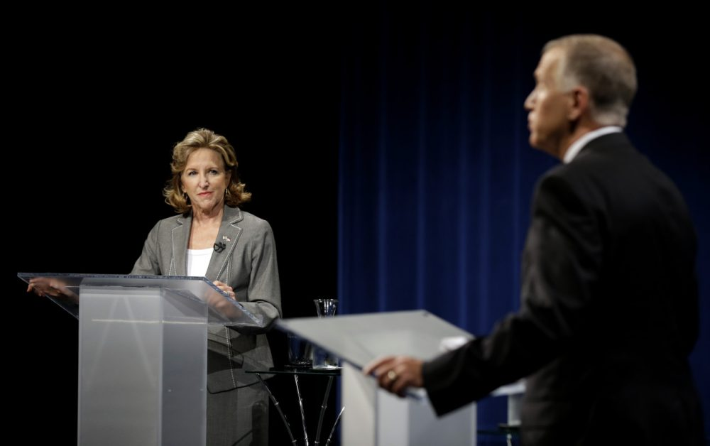 Sen. Kay Hagan, D-N.C., left, and Republican candidate for Senate Thom Tillis participate during a live televised debate at UNC-TV studios in Research Triangle Park, N.C., Wednesday, Sept. 3, 2014. (Gerry Broome/AP)