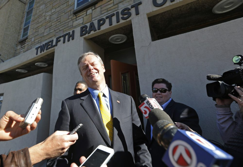 Republican gubernatorial candidate Charlie Baker talks with reporters after speaking to members of The Black Ministerial Alliance of Greater Boston in Roxbury Monday. (Elise Amendola/AP)