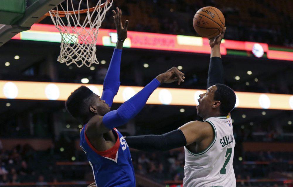 Boston Celtics center Jared Sullinger (7) shoots over Philadelphia 76ers forward Nerlens Noel during the first quarter of a preseason game in Boston on Monday. (Charles Krupa/AP)